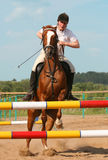 Show jumping. The girl skips on a horse royalty free stock photos