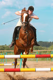 Show jumping. The girl skips on a horse Royalty Free Stock Images