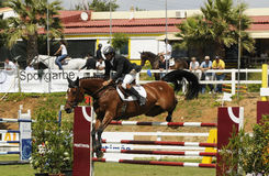 Show jumping. PORTIMAO, PORTUGAL - JUNE 13: Participant in action at  International Show Jumping CS4 Portimao , Portugal,June 13, 2010 in Portimao Stock Image