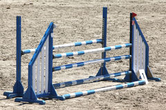 Show jumping barriers on the ground waiting for riders and horse Stock Photo