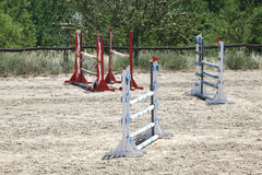 Show jumping barriers on the ground waiting for riders and horse Stock Image