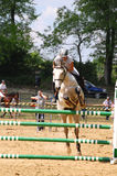 """Show jumping competition. May Day horse-show in Gödöllö - 14 MAY 01, The special horse-show called """"Lovasmajális"""""""" takes place at the St. Stephen Royalty Free Stock Image"""