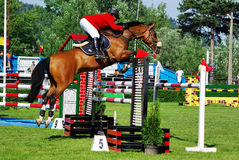 Show jumping horse. Horse jumping hurdle at CSIO2*-W & Balkan Tour, Piatra Neamt (Romania) 4-7 june 2009. Sencer Horasan from Turkey on the horse ''Mylaan D Stock Photo