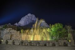 show lights and water funts PEÑA DE BERNAL- is a monolith in the Queretaro state of Mexico stock image