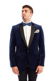 Show man wearing elegant suit and bowtie Royalty Free Stock Photography