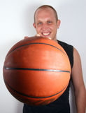 Show Me The Ball. A young man with bright blue eyes and a basketball smiling! Isolated over white Stock Image
