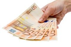 Show me the money. Handing over 5 bills of 50 euro Stock Images