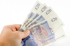 Show me the money. A man holding a number of twenty pound notes Stock Images