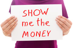Show me the money. Girl holding white paper sheet with text Show me the money Royalty Free Stock Photo