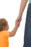 Show me the world. Baby girl holding her mother's hand - concept for childhood and parenthood stock photo