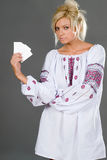 Show me your credit. Pretty girl wearing ethnic clothes with empty cards credit card size in her hand Royalty Free Stock Photos