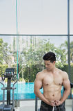 Show muscles body of handsome man in the gym or fitness center, Stock Photography