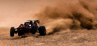 Show Off. A little remote car doing stunt in desert Stock Photos