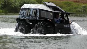 Show off-road capabilities Sherp and Sherp Max all-terrain vehicles in the Velyaminovo. MOSCOW, RUSSIA - JULY 6, 2019: Show off-road capabilities Sherp and Sherp stock video footage