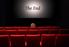 The show is over. Woman sitting alone in the cinema Stock Photos