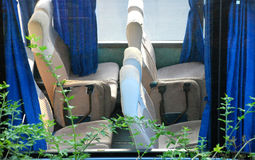 Show seats through window of bus Royalty Free Stock Images