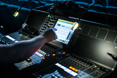 Show sound controller with operators hand Stock Photography
