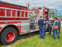 Show and Tell. A family gets a tour of a fire engine at a recent festival in downtown Milwaukee Royalty Free Stock Photo