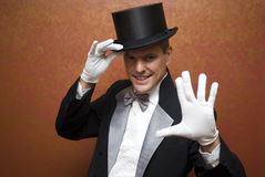 Show time. The illusionist performing a magic trick Royalty Free Stock Photo