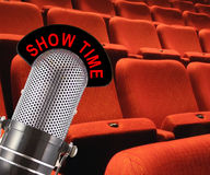 Show Time. 'Show Time' message on vintage microphone with theatre seating in the background Royalty Free Stock Photography