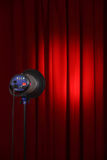 Show time. Curtains and spotted lights with space for your text Royalty Free Stock Photo