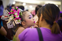 It is show time, make up artist putting lips stick on a little girl Stock Images