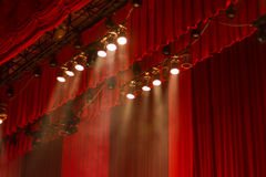 Show time. Red curtains and lights on stage at the show royalty free stock photography