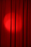 Show time. Spot light on the red curtain of stage Royalty Free Stock Photos