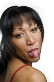 Show tongue. Portrait of a young pretty asian woman stick her tongue out Royalty Free Stock Photo