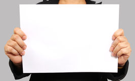 Show white paper. Business woman show white paper on her hand Royalty Free Stock Photography