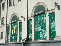 Minsk, Belarus, April 4, 2018: Show-windows of McDonald`s restaurant. McDonald`s is the world`s largest chain of hamburger fast fo Stock Photos