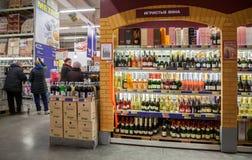 Showcase alcoholic beverages at the hypermarket METRO Royalty Free Stock Photography