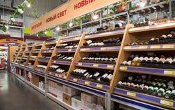 Showcase alcoholic beverages at the hypermarket METRO Stock Photography