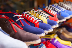 Showcase with casual shoes Stock Photography