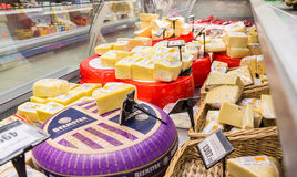 Showcase with cheese ready to sale in grocery shop Royalty Free Stock Photos