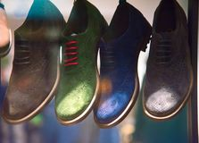 Showcase colored shoes Stock Image
