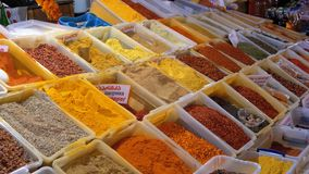 Showcase with Colorful Oriental spices and condiments on the Street market. Batumi, Georgia. Cilantro, hot peppers, sweet peppers, saffron, turmeric, oregano stock video footage