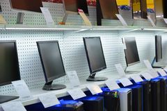 Showcase in a computer store. With monitors and system blocks stock images