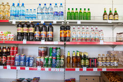 Showcase with different beverages at the grocery store in Russia. BOROVICHI, RUSSIA - JULY 15, 2015: Showcase with different beverages at the grocery store in Stock Images