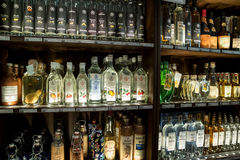 Showcase with different varieties of alcohol in the Alois Dallmayr. Stock Photos