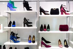 Showcase of fashion store with bags and shoes. Showcase of a fashion store with bags and shoes Stock Photography