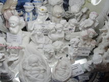 Showcase gift shops, historical Central and the largest Department store of St. Petersburg, Seating Yard. Children`s toys and Souvenirs. porcelain angel Cupid Stock Photos
