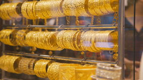 Showcase with gold bracelets. Jewelry store. Gold bracelets for sale. stock video