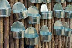 Showcase of handmade tin flowerpots planters Stock Photos