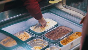 Showcase with Ice Cream Sold by Weight stock video footage