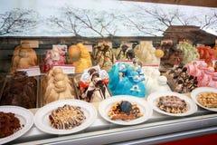 Showcase of ice cream in window display at Rambla street Royalty Free Stock Image
