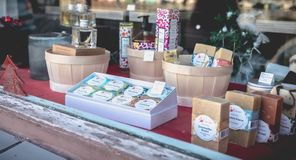 Showcase of a local cometic products store in Sete. Sete, France - January 4, 2019: Showcase of a local cometic products store and soap on a winter day stock photo