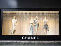 Chanel showcase Trend Summer 2018 Printemps Haussmann. A showcase of luxury brand Coco Chanel at the Printemps department store. Four blond female mannequins royalty free stock image