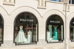 Showcase of a luxury clothes store Rosa Clara stock image