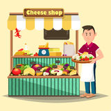 Showcase with man selling cheese products Stock Images